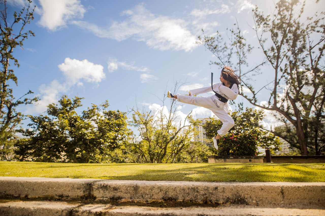 woman doing martial arts in nature